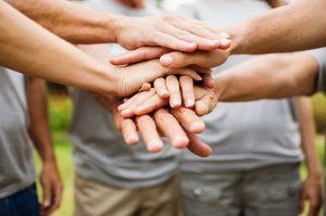 Hands crossing hands
